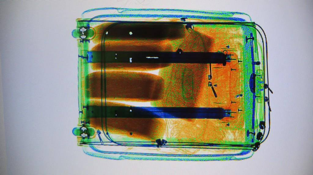 Here is what an X-Ray of 11 kilos of cocaine bricks in a suitcase looks like to border agents at Toronto airport. Photo Credit: Adrian Humphreys
